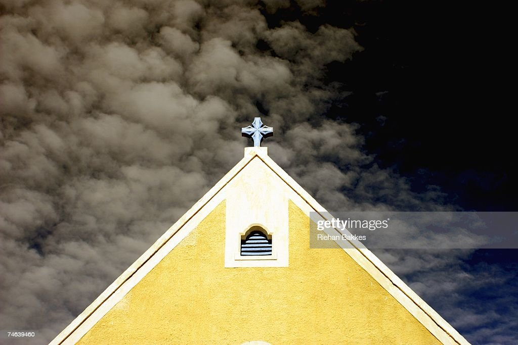 Low Angle View of Church with Moody Sky Background