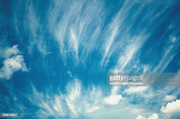 Low angle view of cirrus clouds in the blue sky