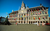 Low angle view of City Hall and Brabo Fountain, Mail Square, Antwerp, Belgium