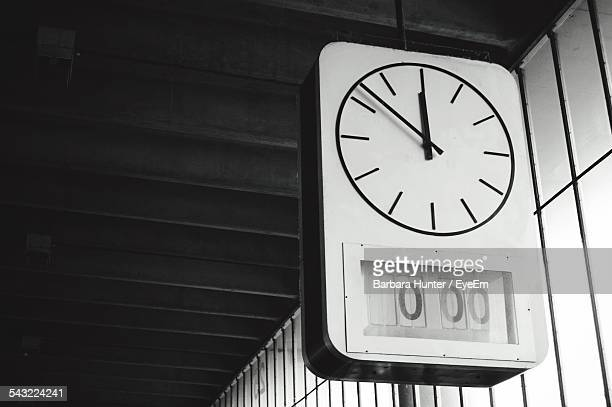 Low Angle View Of Clock At Bus Station