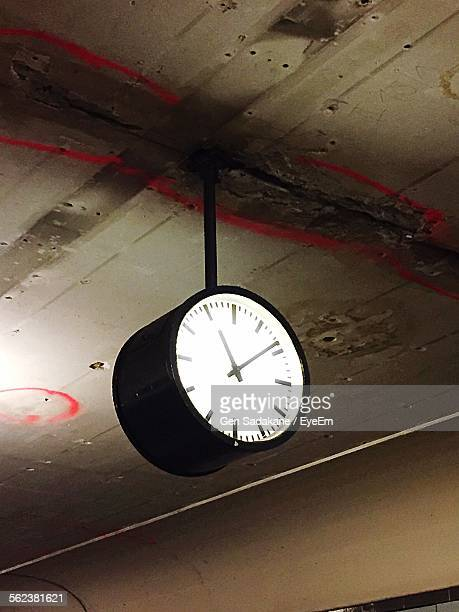 Low Angle View Of Clock Hanging On Ceiling Indoors