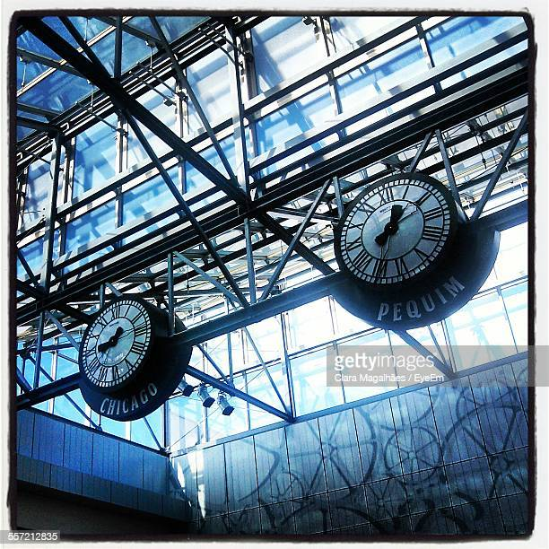 Low Angle View Of Clocks In Airport
