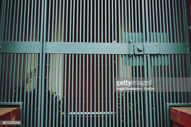 Low Angle View Of Closed Metal Gate