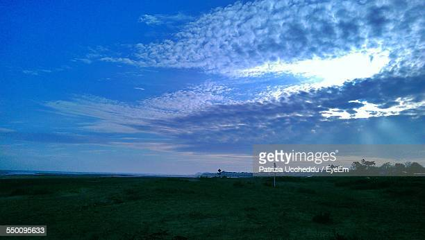 Low Angle View Of Cloudy Sky Over Field