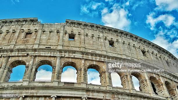 Low Angle View Of Coliseum Against Blue Sky