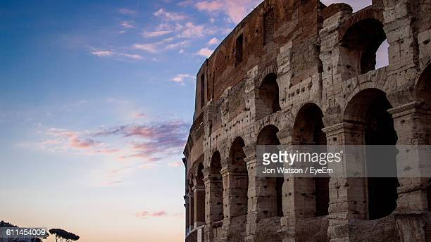 Low Angle View Of Coliseum Against Sky In City