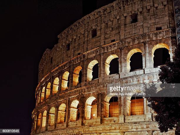 Low Angle View Of Coliseum At Night