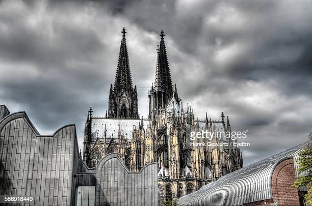 Low Angle View Of Cologne Cathedral Against Cloudy Sky