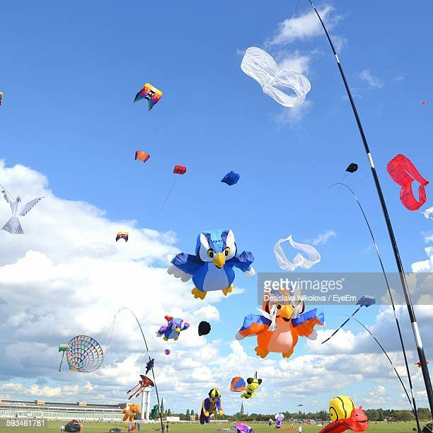 Low Angle View Of Colorful Animal Shaped Kites Flying Against Sky