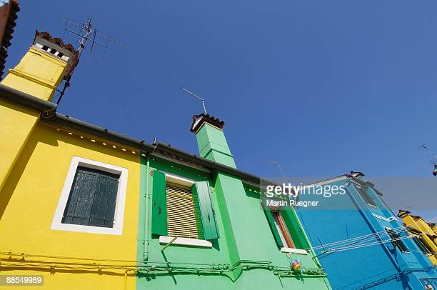Low angle view of colorful houses, Venice, Italy