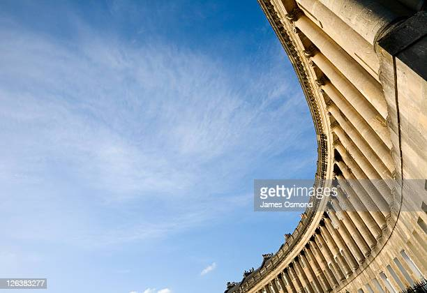 Low angle view of column fronted houses on The Royal Crescent in Bath, built between 1767 and 1775 this semi-ellicpitcal row of houses is heralded as a masterpiece of Palladian design, in the historic south-west city designated a World Heritage Site