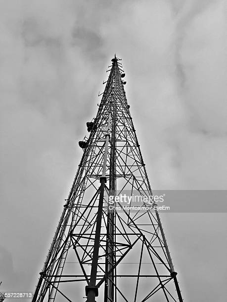 Low Angle View Of Communication Tower Against Cloudy Sky