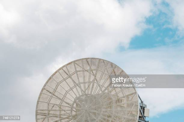 Low Angle View Of Communications Radar Against Cloudy Sky