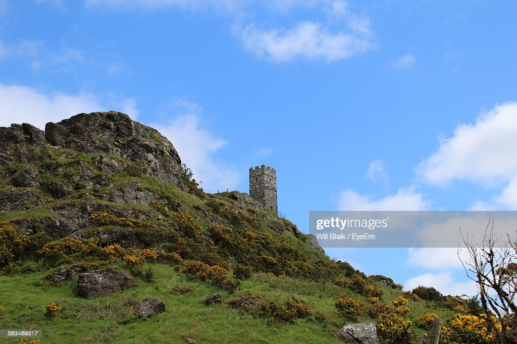 Low Angle View Of Countryside Landscape Against Blue Sky