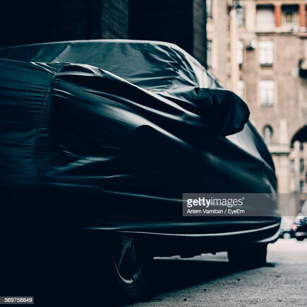 Low Angle View Of Covered Car Parked In Alley