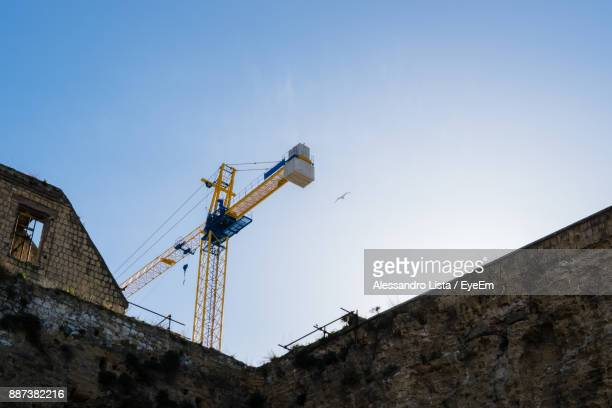 Low Angle View Of Crane Against Clear Sky