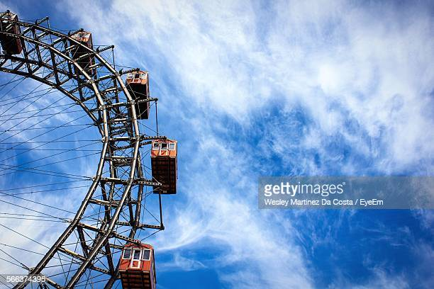 Low Angle View Of Cropped Ferris Wheel Against Sky