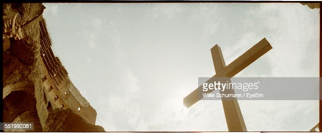 Low Angle View Of Cross Against The Sky