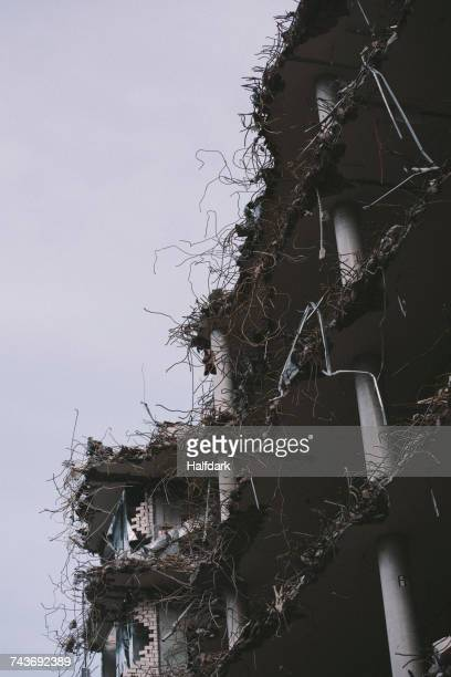 Low angle view of demolished building against sky