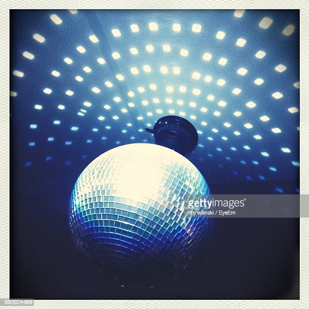 Low Angle View Of Disco Ball In Nightclub