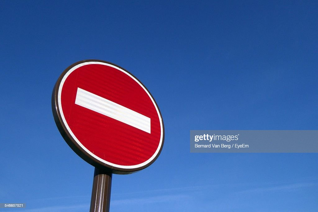 Low Angle View Of Do Not Enter Sign Against Clear Blue Sky
