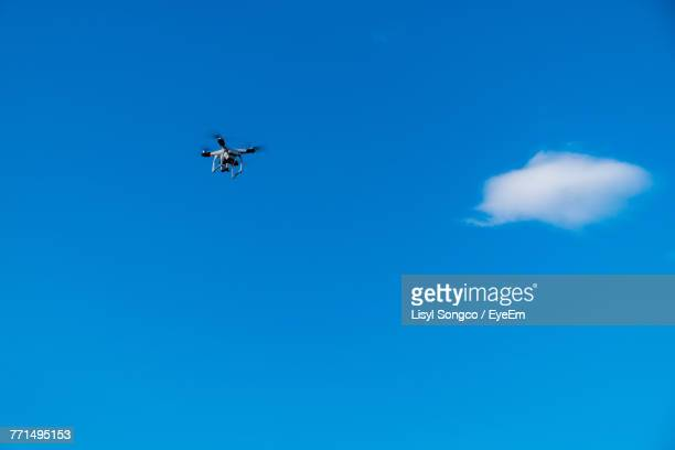 Low Angle View Of Drone Flying In Blue Sky