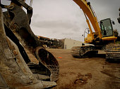 Low Angle View Of Earth Mover At Construction Site Against Sky