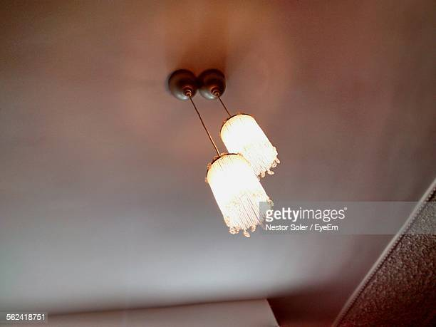 Low Angle View Of Electric Lamps On Ceiling