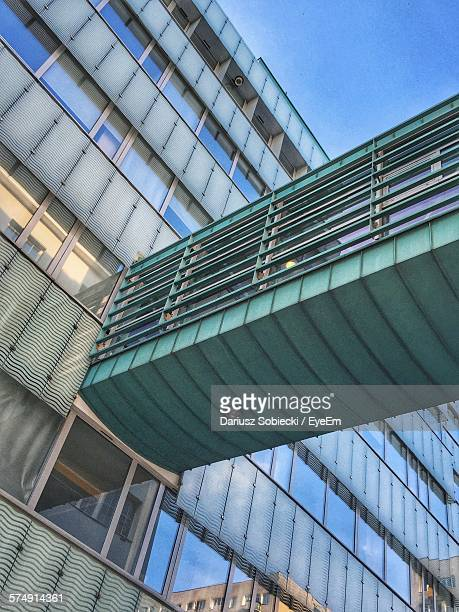 Low Angle View Of Elevated Walkway Connected To Building In City