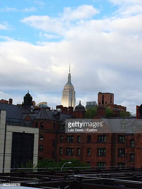 Low Angle View Of Empire State Building Against Cloudy Sky