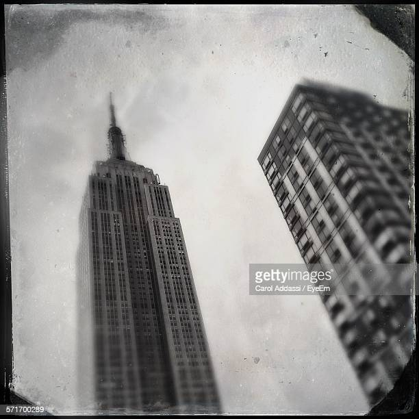 Low Angle View Of Empire State Building In City Against Sky