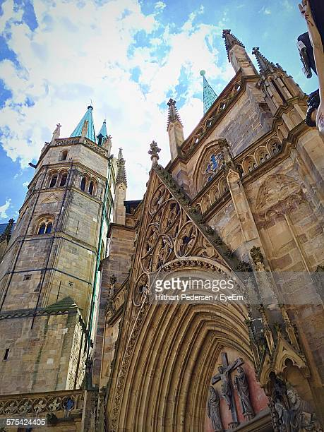 Low Angle View Of Erfurt Cathedral Against Cloud Sky