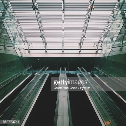 Low Angle View Of Escalators Against Ceiling At Changi International Airport