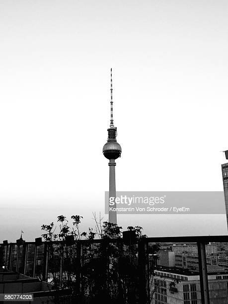 Low Angle View Of Fernsehturm Tower In City Against Clear Sky