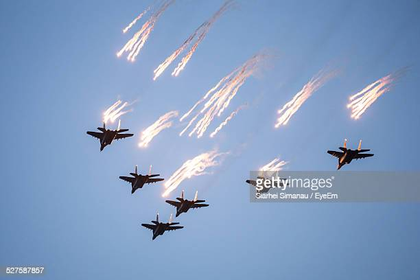 Low Angle View Of Fighter Planes In Clear Sky