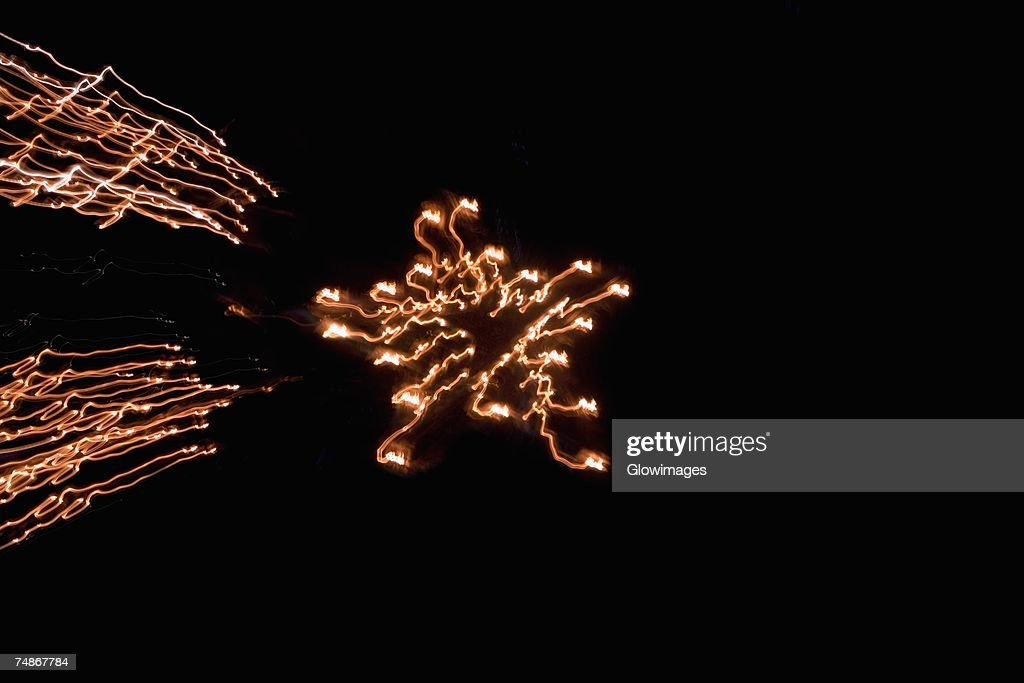 Low angle view of fire crackers exploding in the night sky : Stock Photo