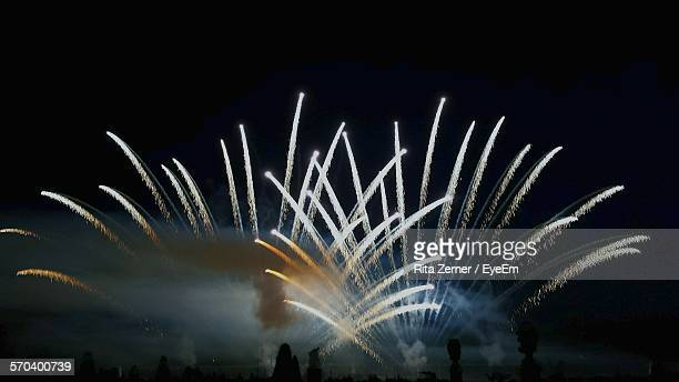 Low Angle View Of Firework Explosion With Smoke At Night In Herrenhausen Gardens