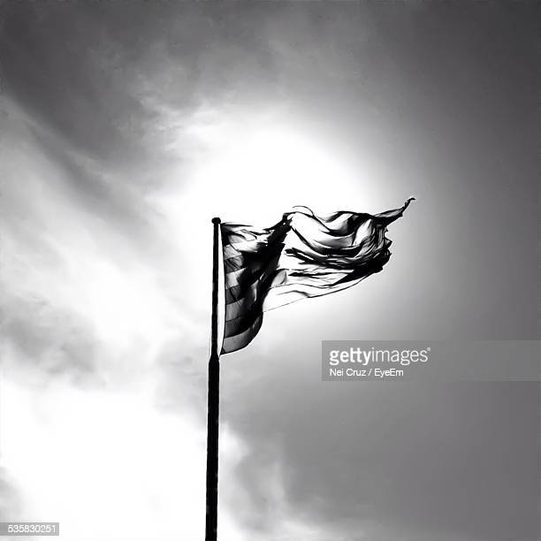 Low Angle View Of Flag Against Sky On Sunny Day