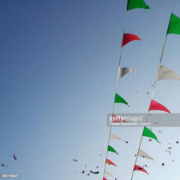 Low Angle View Of Flags Against Clear Sky