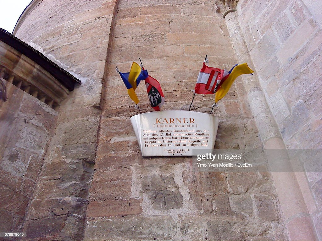 Low Angle View Of Flags On Church Wall : Stock-Foto
