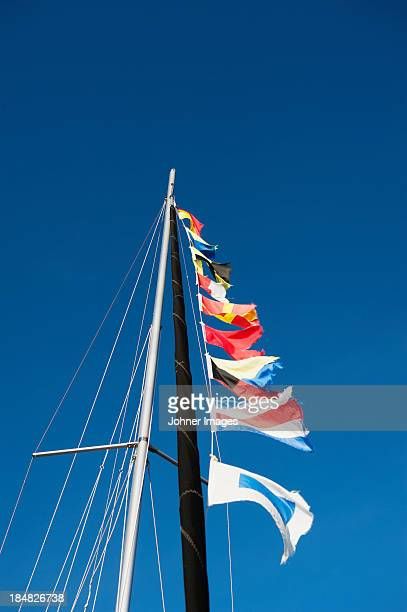 Low angle view of flags on mast rope