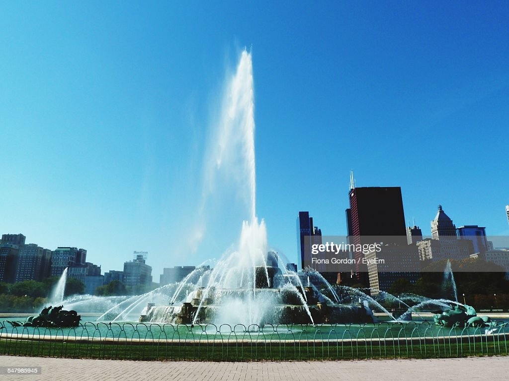 Low Angle View Of Fountain Against Buildings