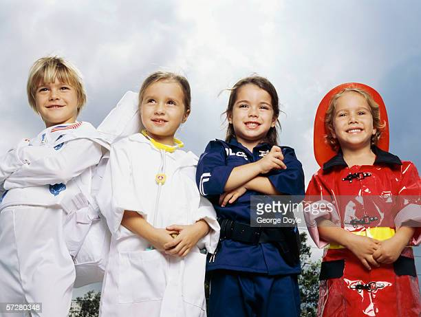 Low angle view of four children pretending to be grown-ups