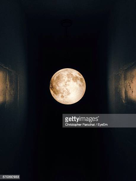 Low Angle View Of Full Moon Against Clear Sky At Night