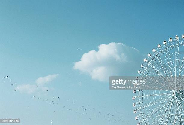 Low Angle View Of Giant Ferris Wheel Against Sky