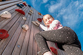Low Angle View of Girl Climbing Rock Wall Outdoors