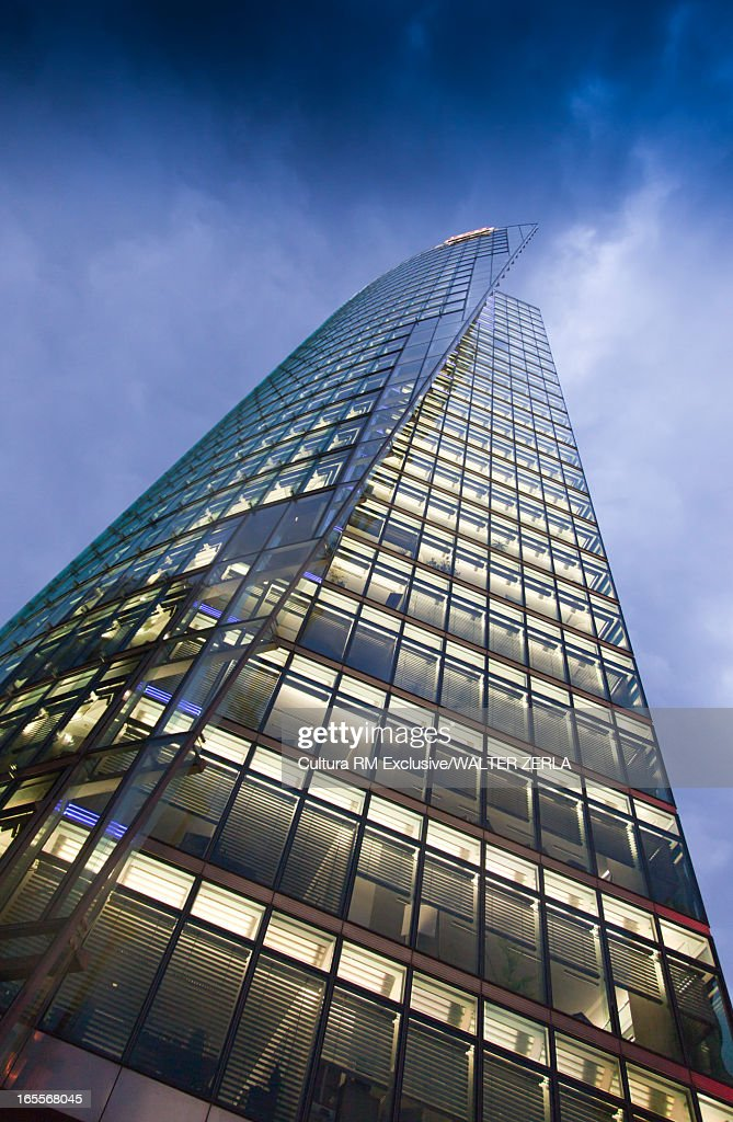Low angle view of glass skyscraper : Stock Photo