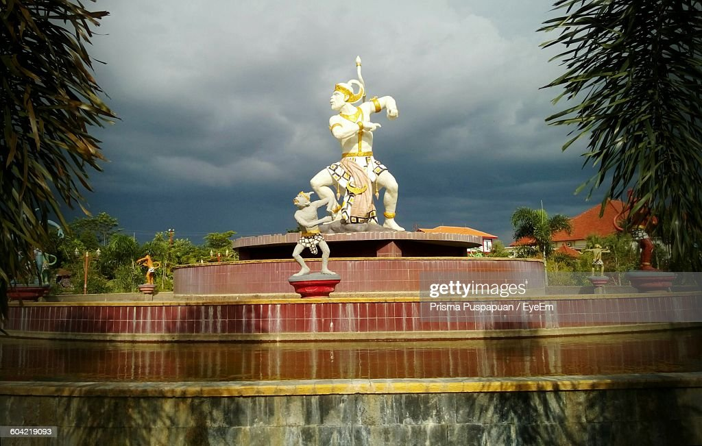 Low Angle View Of God Statue Against Cloudy Sky