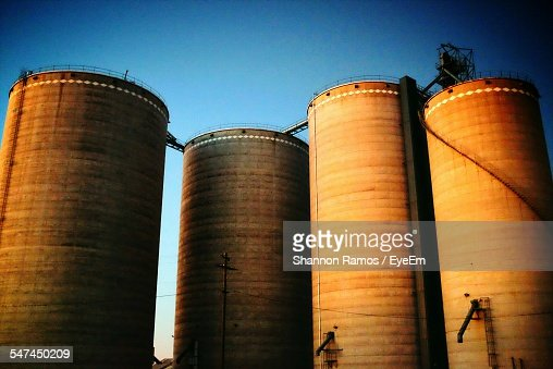 Low Angle View Of Grain Silos