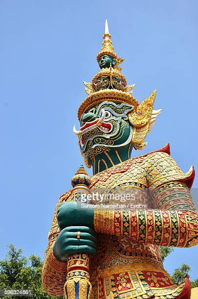 Low Angle View Of Guardian Statue Against Clear Sky At Wat Phra Kaew